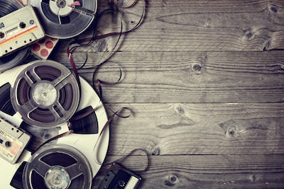 Old audio reels and cassette tape background