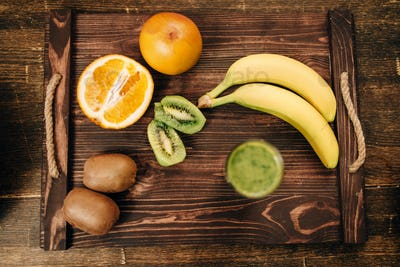 Fruits on wooden tray closeup, nobody, top view