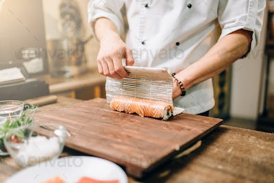 Male person cooking seafood, japanese kitchen