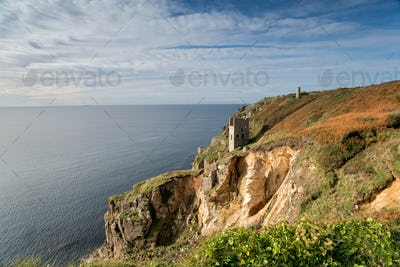 Engine houses perched dramatically on the edge of cliffs at Rinsey near Porthleven in Cornwall