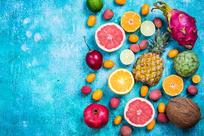 Exotic fruits top view border background