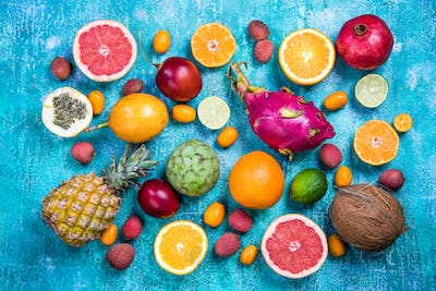 Exotic fruits on vibrant concrete slate,flat lay