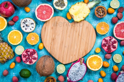 Wooden heart shape copy space with exotic fruits