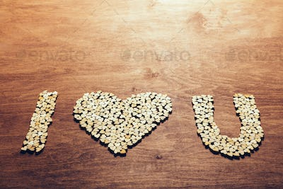 """I love you"" symbol made from wooden hearts."
