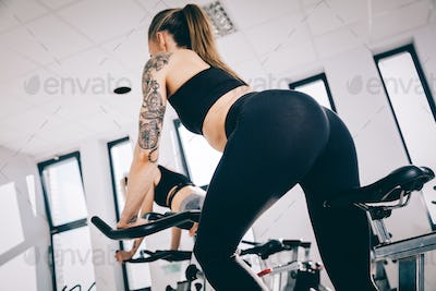Athletic woman spinning in a gym.