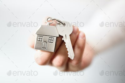 Real estate agent giving house keys