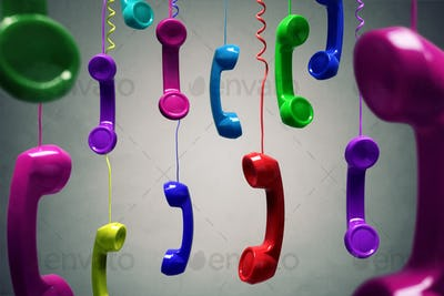 Red and multi-coloured telephone receiver hanging