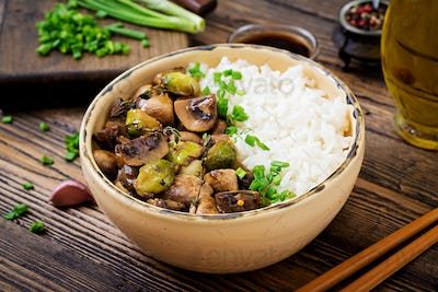 Vegan menu. Dietary food. Boiled rice with mushrooms and Brussels sprouts in Asian style.