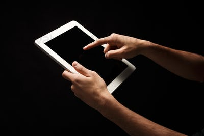 Holding and pointing to blank screen on tablet