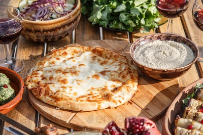 Traditional Georgian bread with cheese - khachapuri