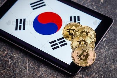 Golden bitcoins and South Korea flag.