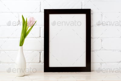 Black brown  frame mockup with soft pink tulip in vase