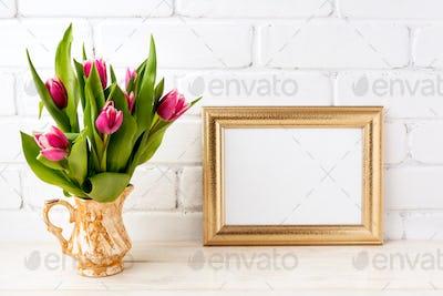 Golden  landscape frame mockup with pink tulips in jug