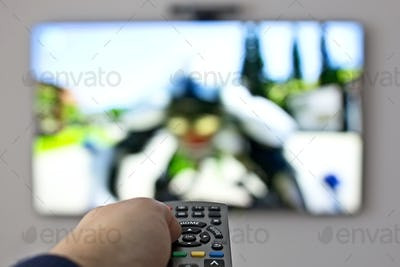 Tv and hand pressing remote control