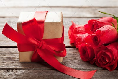 Valentines day gift box and red roses