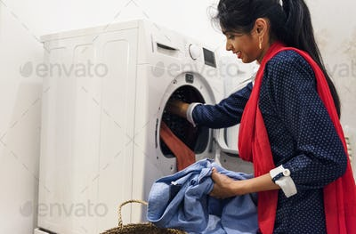 Indian woman doing a laundry
