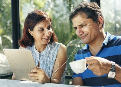 Couple spending time together in outdoor resort in jungle
