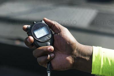 Closeup of hand holding stopwatch