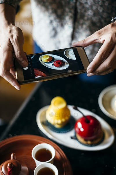Woman taking a photo of her food