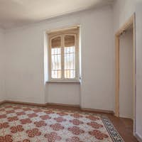 Old, empty room interior with tiled, decorated floor