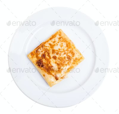 Pancake stuffed with ham and cheese.