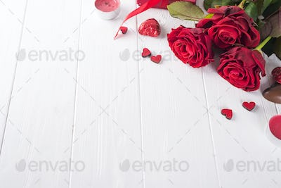 red roses and chocolate candies for Valentine's Day