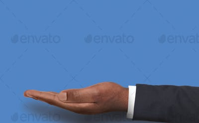 Outstretched male hand over pink background
