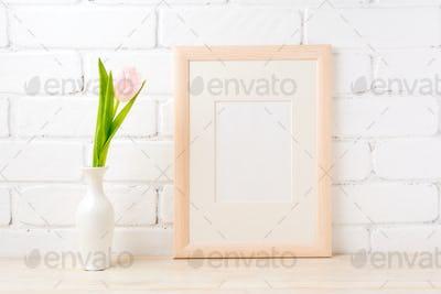 Wooden frame mockup with pale pink tulip in vase