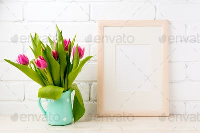 Wooden frame mockup with pink tulips in jug