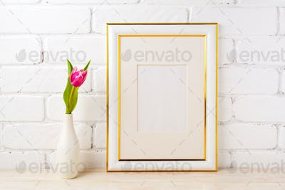 Gold decorated frame mockup with magenta pink tulip