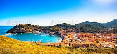 Porto Ercole village panorama and harbor in a sea bay. Aerial vi