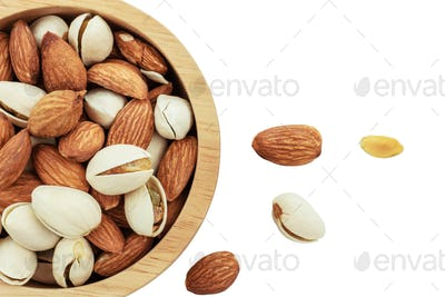 Almond in bowl on white background