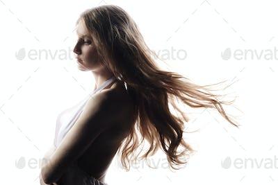 Fashion portrait young elegant woman with a redhead hair