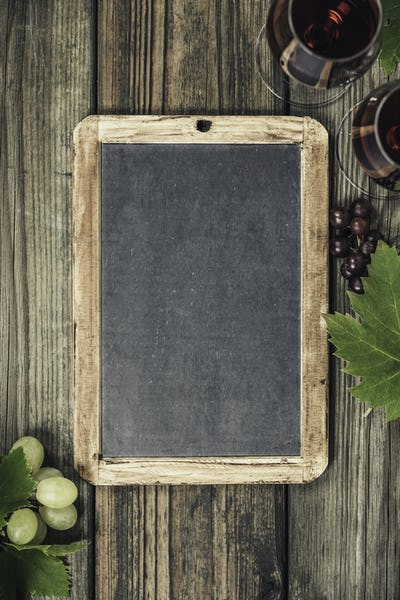 Wine and grapes over wood vintage background