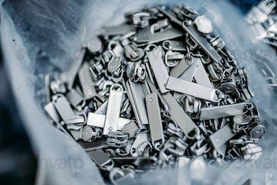 Zipper sliders for clothes closeup, nobody
