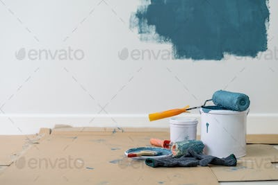 Paint bucket with roller, glove and brush
