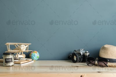 Travel accessories and items on wooden table