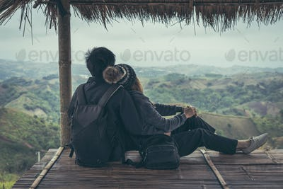 Young couple sitting and looking view of nature