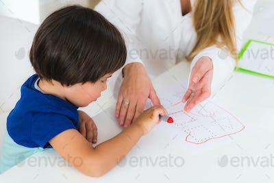 Child psychology, toddler doing logic tests with shapes