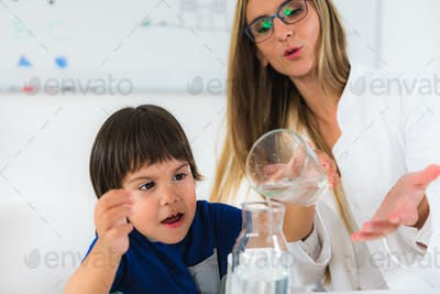 Child psychology, toddler doing tests with water and glasses