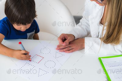 Child psychology, toddler doing logic tests with shapes