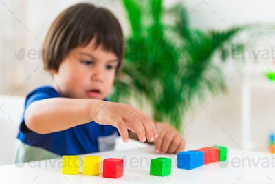 Child psychology, little boy doing test with blocks