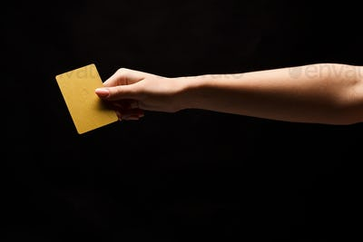 Closeup of female hand holding blank plastic card