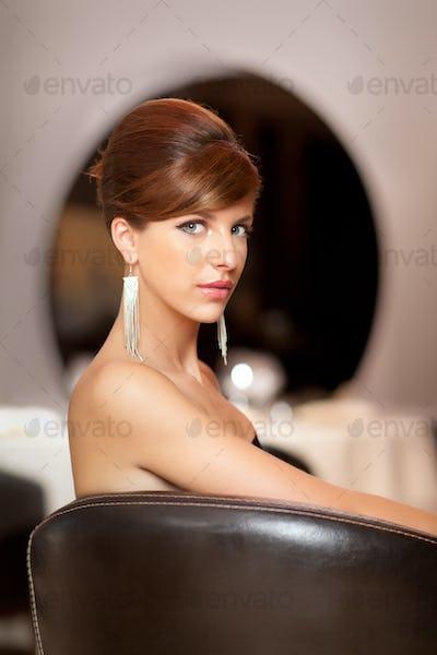 elegant woman posing at camera