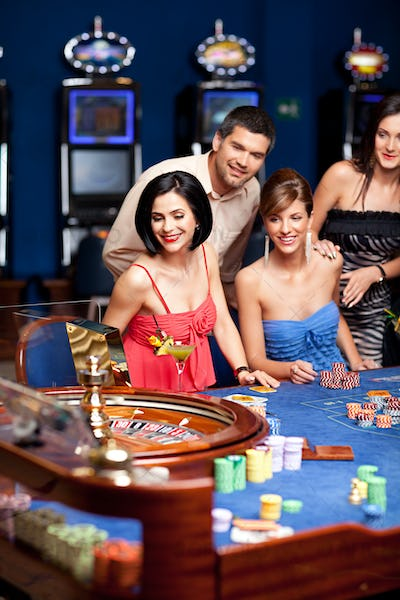group of elegant people playing roulette