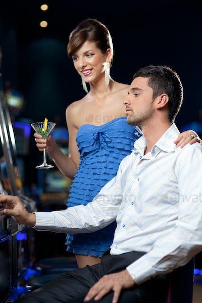 slot machine playing couple