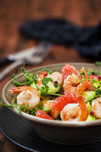 Delicious fresh salad with prawns, grapefruit, avocado, cucumber