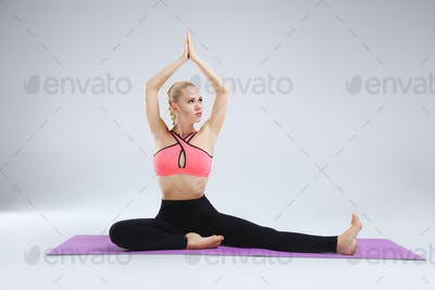 Stretching in the white studio