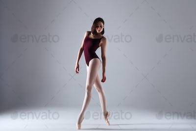 Ballerina dancing in the darkness