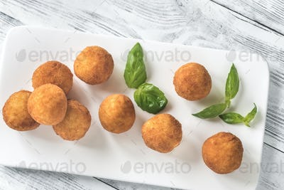 Rustic bowl of arancini